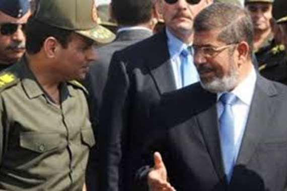 الرئيس عبد الفتاح السيسي و الراحل محمد مرسي