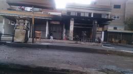 بالصور.. حصر تلفيات حريق محطة وقود بملوي