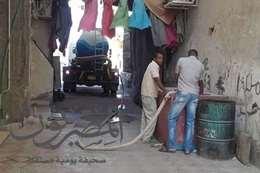 صور السيارات أثناء توزيع المياه