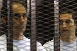 علاء وجمال مبارك داخل قفص الاتهام