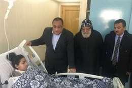 رئيس جامعة حلوان يزور مصابى كنيسة مارمينا