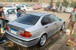 مغاسل السيارات  العشوائية تنتشر على الطرق الرئيسية بالبحيرة