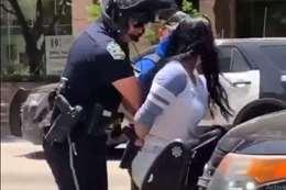 شرطي يعتقل فتاة