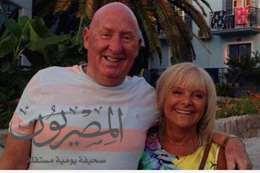 صورة السائح الانجليزى وزوجته المتوفيان بأزمة ?لبية