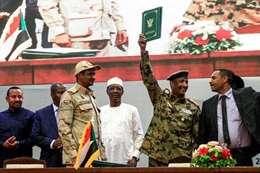 جانب من توقيع اتفاقية الإعلان الدستوري