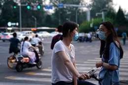 اكتشاف فيروس كورونا على عبوات المأكولات البحرية بالصين