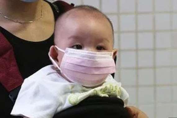 تحذير من خطورة ارتداء الأطفال دون سن الثالثة للكمامة