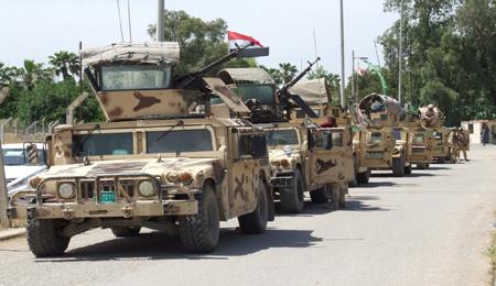"""الأمن يحرر مطار الضلوعية من """"داعش"""" ويرفع علم العراق"""